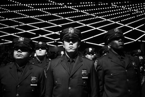 A NYPD ceremony in 2018.Credit...Damon Winter/The New York Times